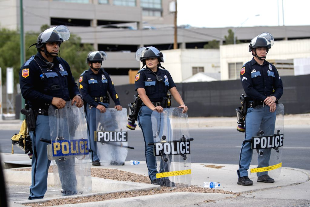 EL PASO, Aug. 8, 2019 (Xinhua) -- Riot police stand guard on the street as Trump visits a nearby hospital for treating shooting injured persons, in El Paso, Texas, the United States, Aug. 7, 2019. U.S. President Donald Trump and First Lady Melania Tr