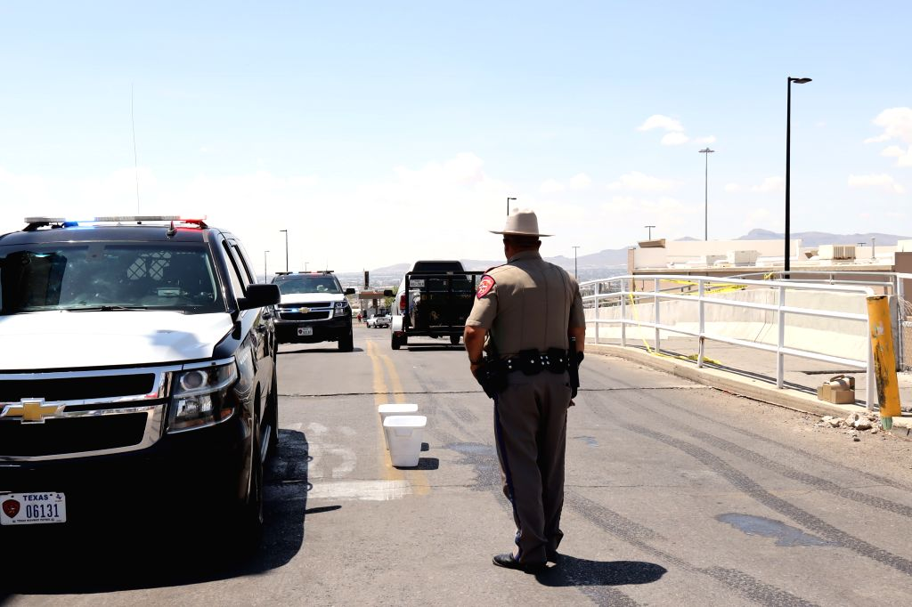 EL PASO (U.S.), Aug. 4, 2019 A policeman stands guard near the Walmart shopping mall area in El Paso of Texas, the United States, on Aug. 4, 2019. The U.S. federal government is treating ...