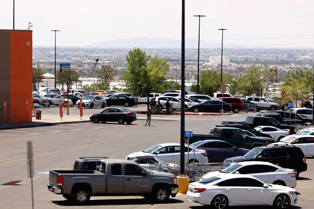 EL PASO (U.S.), Aug. 4, 2019 Federal Bureau of Investigation (FBI) agents work on the shooting scene at Walmart shopping mall area in El Paso of Texas, the United States, on Aug. 4, 2019. ...