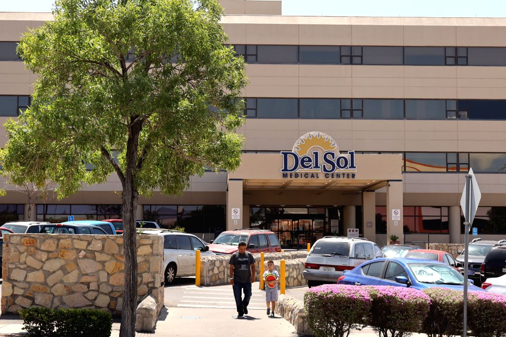 EL PASO (U.S.), Aug. 4, 2019 People walk out from the Del Sol Medical Center, where several people injured from the mass shooting receive medical treatment, in El Paso of Texas, the ...