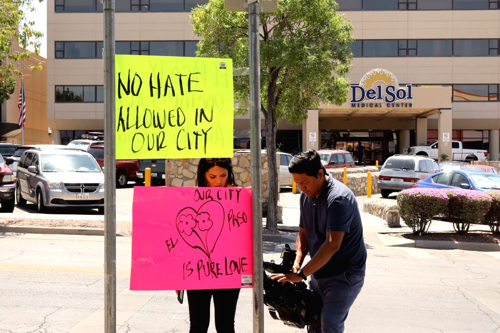 EL PASO (U.S.), Aug. 4, 2019 Reporters film the placards in front of the Del Sol Medical Center, where several people injured from the mass shooting receive medical treatment, in El Paso ...