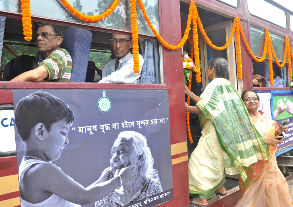 Elderly people board a tram during a tram ride organised for senior citizens on the occasion of World Elder Abuse Awareness Day in Kolkata, on June 15, 2019.