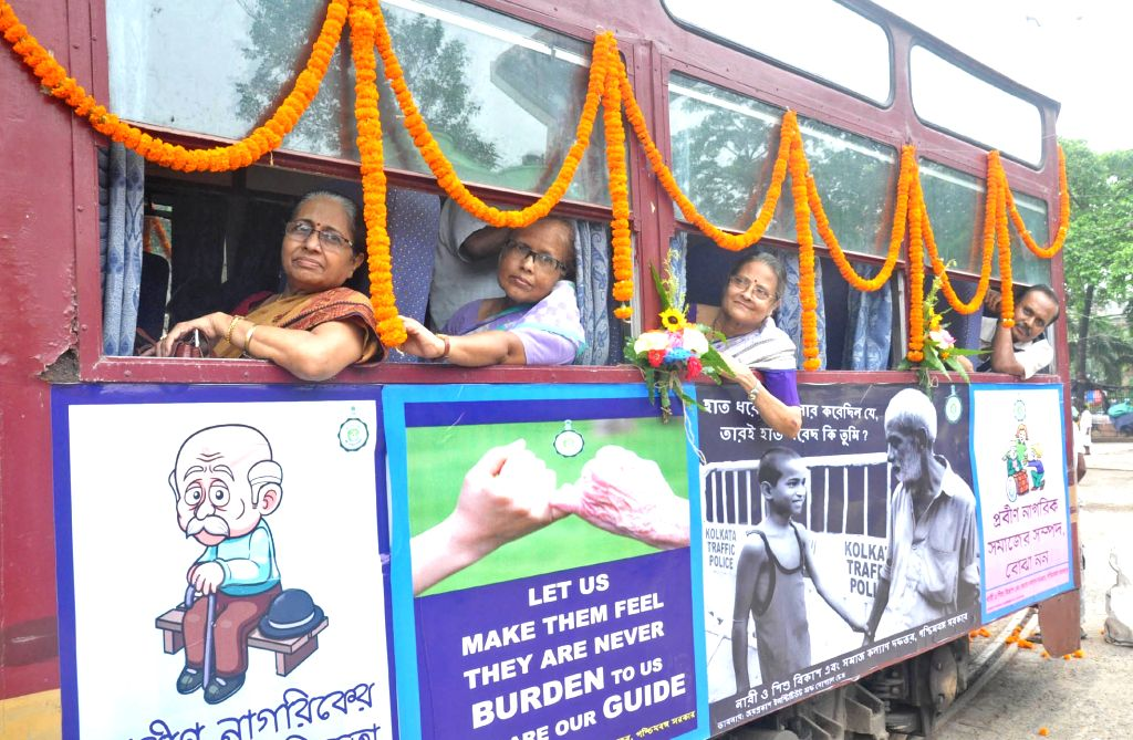 Elderly women enjoy tram ride organised for senior citizens on the occasion of World Elder Abuse Awareness Day in Kolkata, on June 15, 2019.