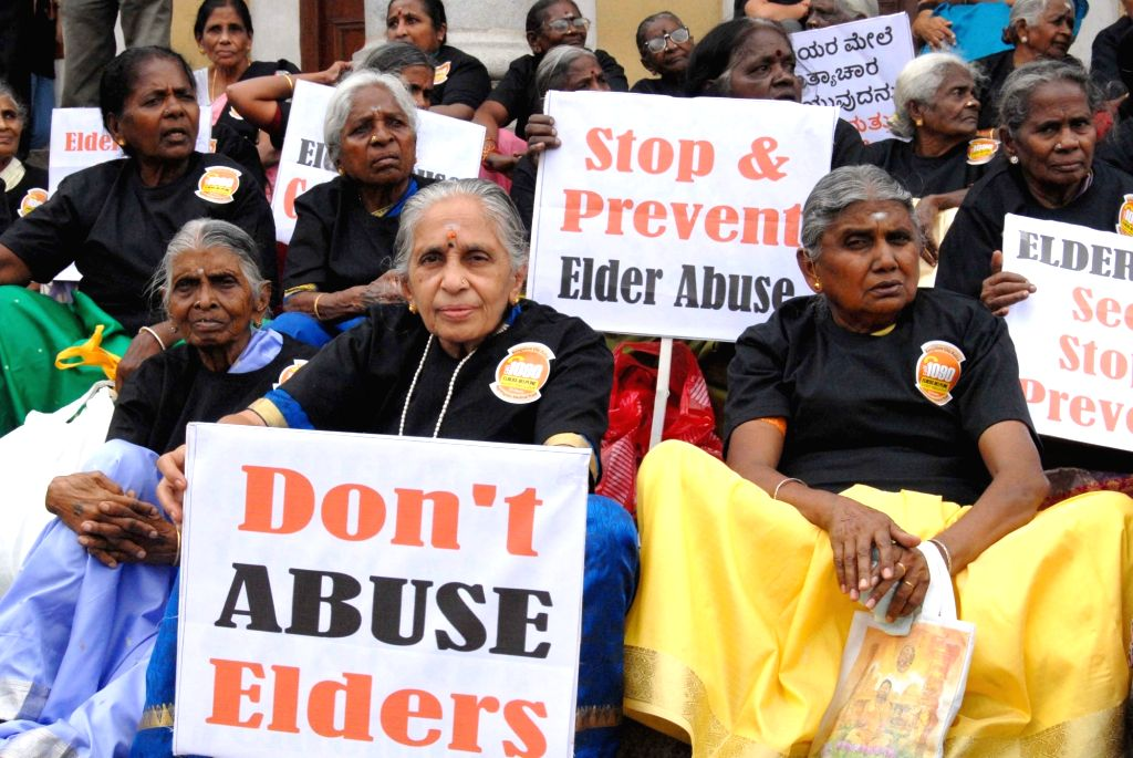 Elderly women hold placards during a rally organised on World Elder Abuse Awareness Day in Bengaluru, on June 15, 2017.