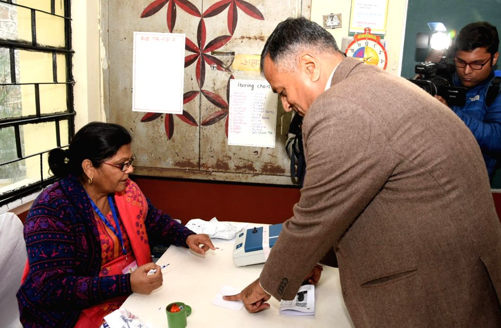 Election Commissioner Ashok Lavasa being administered indelible ink by a polling official after he cast his vote for Delhi Assembly elections 2020 at Atal Adarsh Vidyalya in Delhi's ...