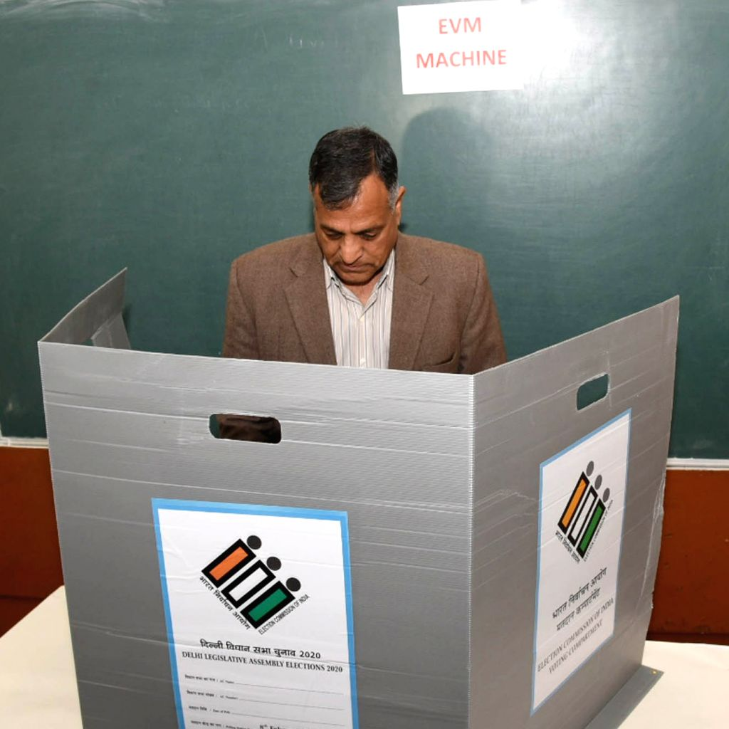 Election Commissioner Ashok Lavasa casts his vote for Delhi Assembly elections 2020 at Atal Adarsh Vidyalya in Delhi's Chanakya Puri on Feb 8, 2020.