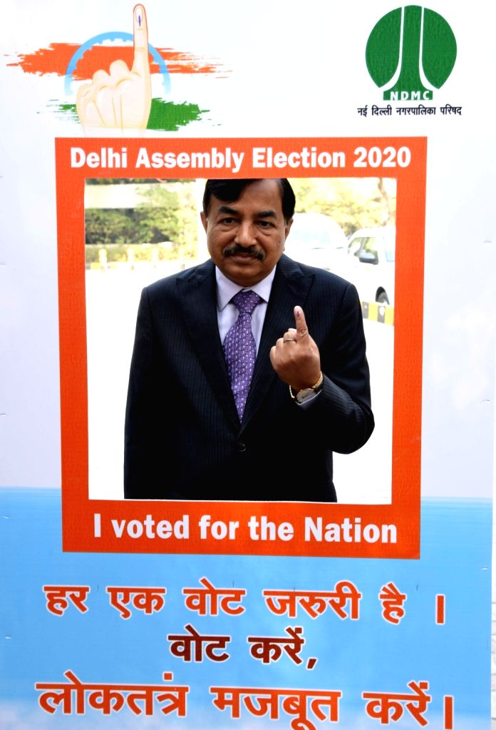 Election Commissioner Sushil Chandra poses for a photograph after casting his vote for Delhi Assembly elections 2020 at Wonderland Kids School in Delhi's New Moti Bagh on Feb 8, 2020.