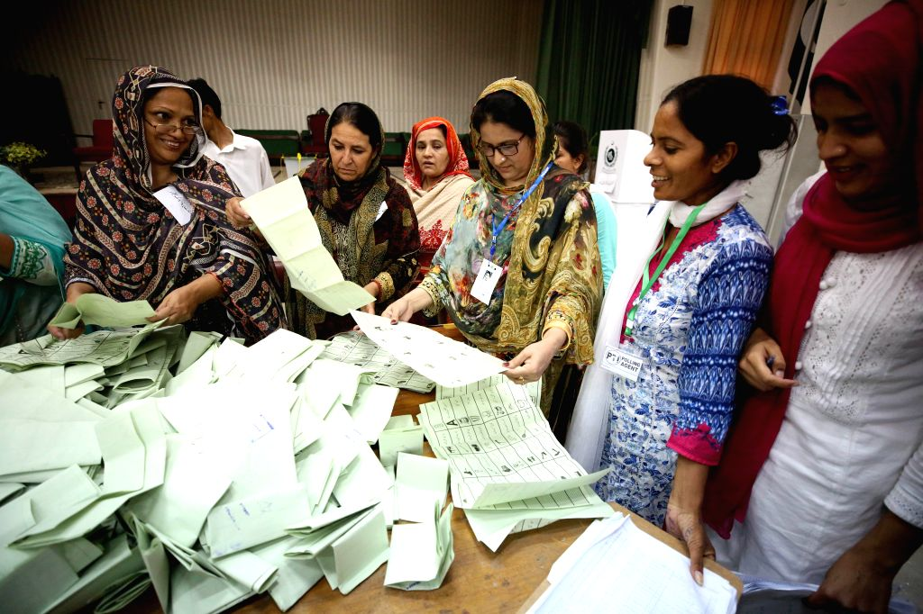 : Election officials count votes in Islamabad, capital of Pakistan, on July 25, 2018. Pakistanis started casting votes in the country's one-day general ...