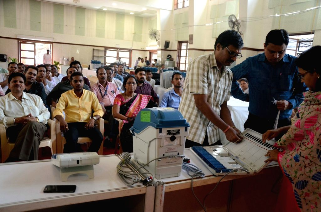 Election officials demonstrate the functioning of an Electronic Voting Machine (EVM) and Voter Verified Paper Audit Trail (VVPAT) ahead of 2019 Lok Sabha polls during a voter awareness ...
