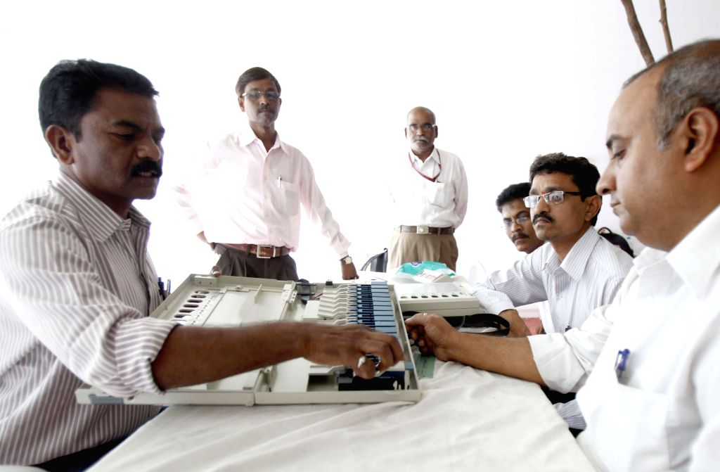Election officials given training on operations of electronic voting machines in Mumbai on April 17, 2014.