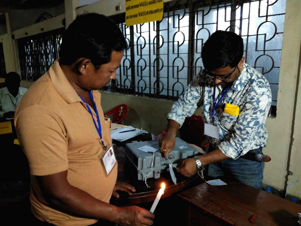Election officials seal Electronic Voting Machines (RVM) and Voter-verified paper audit trails (VVPAT) after the completionof voting for the first phase of 2019 Lok Sabha elections, in ...