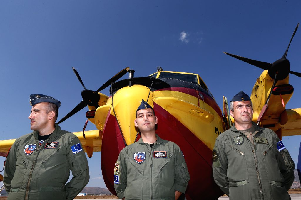 ELEFSINA (GREECE), Sept. 12, 2019 Fire-fighting aircraft pilots pose at Elefsina's airbase, near Athens, Greece, on Sept. 12, 2019. Greece joined the new RescEU system with two ...