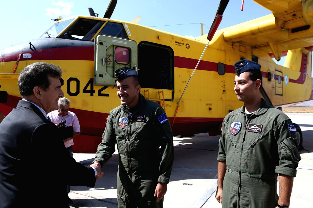 ELEFSINA (GREECE), Sept. 12, 2019 Greek Citizen Protection Minister Michalis Chrysochoidis (1st L, Front) shakes hands with a fire-fighting aircraft pilot at Elefsina's airbase, near ... - Michalis Chrysochoidis
