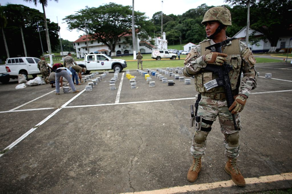 Elements of the National Air and Naval Service (SENAN) guard drug packages during a press conference, in the City of Panama, capital of Panama, on July 27, ...