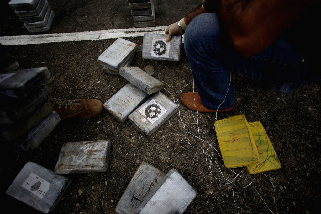 Elements of the National Air and Naval Service (SENAN) place drug packages during a press conference, in the City of Panama, capital of Panama, on July 27, ...