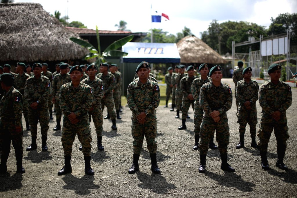 Elements of the National Border Service (SENAFRONT), take part in a graduation ceremony in Meteti village, Darien province, Panama, on Nov. 23, 2015. According to ...