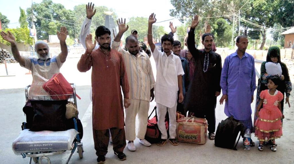 Eleven Pakistani prisoners going back home after India released them following completions of their jail term, at Attari international border about 30 kms from Amritsar on July 25, 2017.