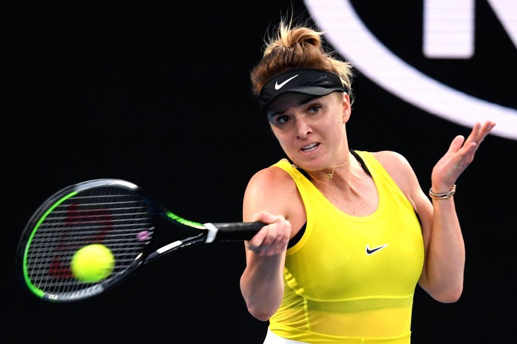Elina Svitolina of Ukraine returns the ball during the women's singles third round match against Garbine Muguruza of Spain  at the 2020 Australian Open tennis ...