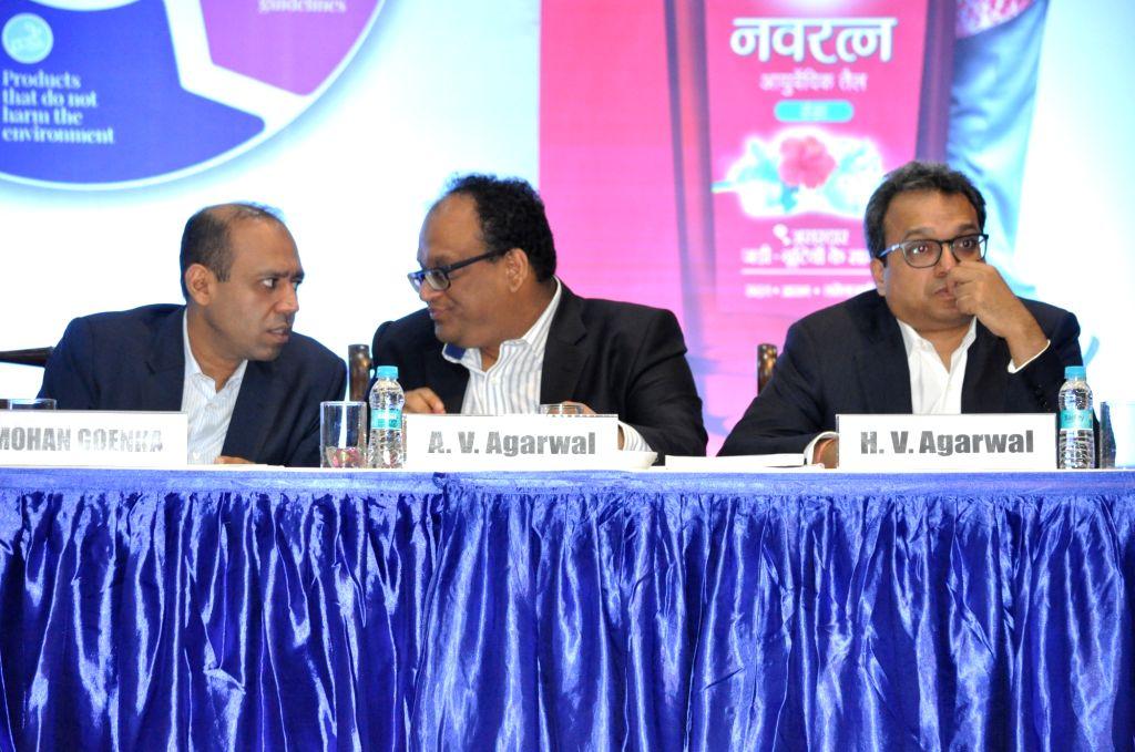 Emami Limited Whole-time Directors Mohan Goenka and Harsha V. Agarwal and Non-Executive Director Aditya V. Agarwal during the company's Annual General Meeting (AGM), in Kolkata on Aug 1, ... - Mohan Goenka
