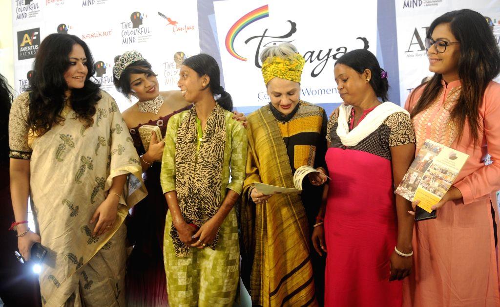 Eminent danseuse Alokananda Roy, fashion designer Agnimitra Paul, singer Iman Chakraborty and others during a press conference of 'Tanaya 2018 - The Queen of Kolkata'; in Kolkata on July 19, ... - Alokananda Roy and Iman Chakraborty