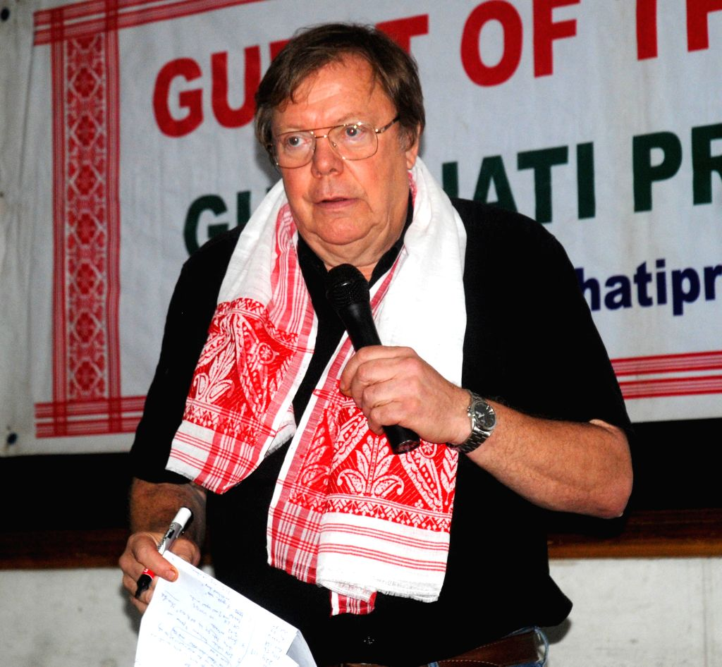Eminent journalist Bertil Lintner being felicited with a Assamese traditional Japi and Gamocha during the Guest of the Month function in Guwahati on Oct 24, 2015.