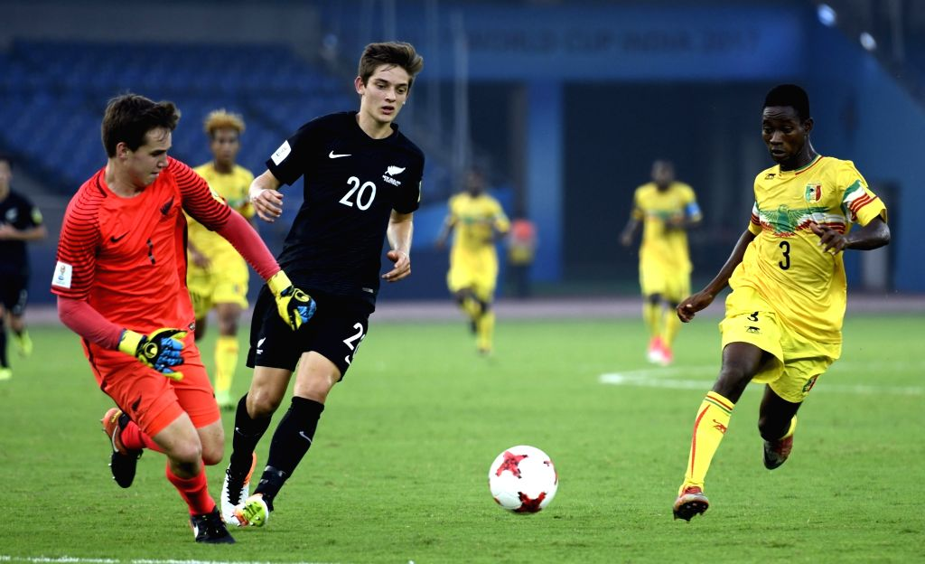Emlyn Wellsmore (Black Jersey No - 20) of New Zealand and Djemoussa Traore (Yellow Jersey No-3) of Mali in action during a FIFA U-17 World Cup Group A match between Mali and New Zealand at ...