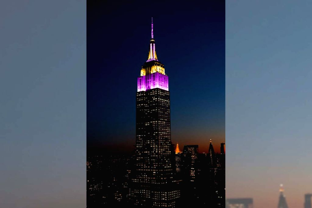 Empire State Building lit up in purple and gold to honor Bryant.