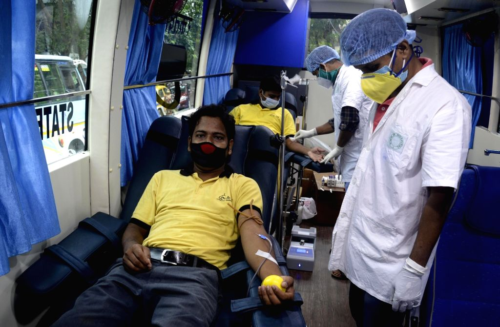 Employees of a city hotel donate blood during a mobile blood donation camp, in Kolkata on July 4, 2020.