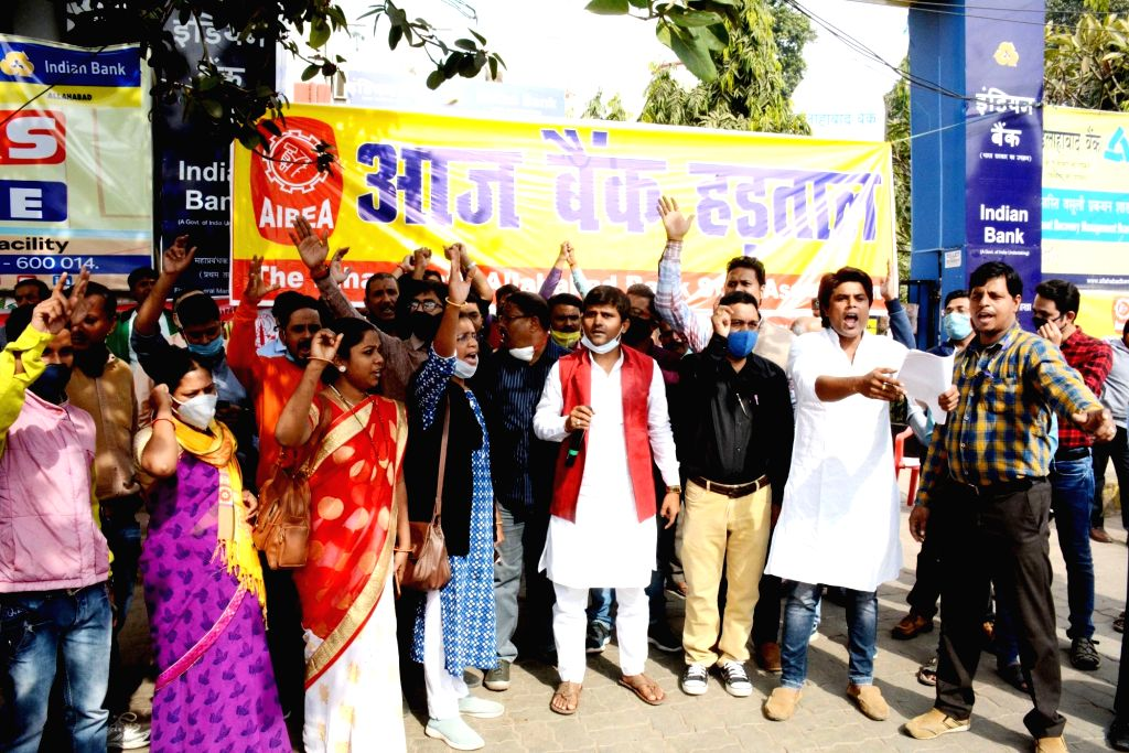 Employees of Indian Bank protest during the 24-hour nationwide trade union strike called by the central trade unions against the central government's new farm and labour laws, in Patna on Nov ...