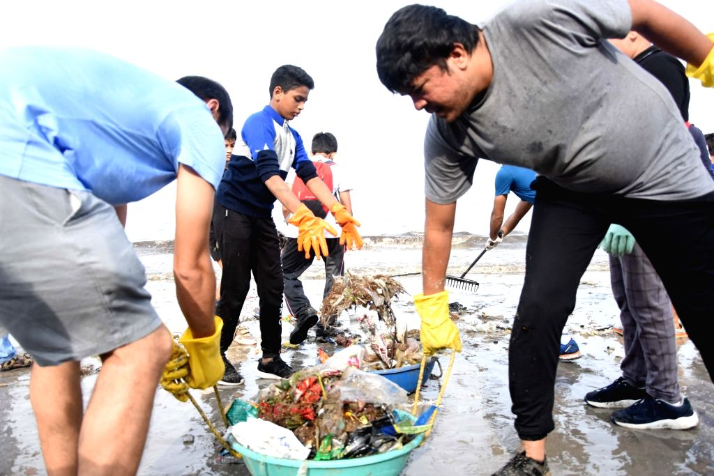 Employees of Shapoorji Pallonji Group participate in a cleanup drive at Mahim beach in Mumbai on Sep 14, 2019.