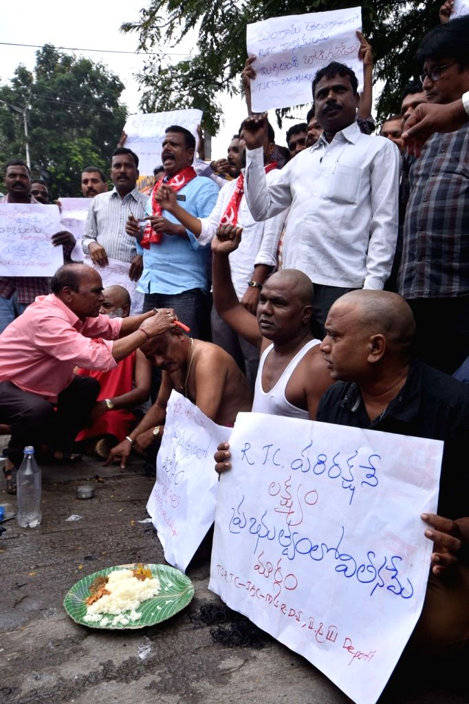 Employees of Telangana State Road Transport Corporation (TSRTC) get their heads shaved during the 12th day of their strike, in Hyderabad on Oct 16, 2019.