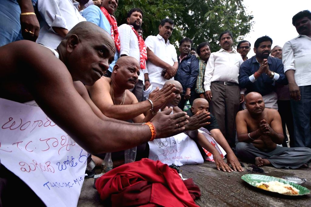 Employees of Telangana State Road Transport Corporation (TSRTC) beg after getting their heads shaved as a mark of protest during the 12th day of their strike, in Hyderabad on Oct 16, 2019.