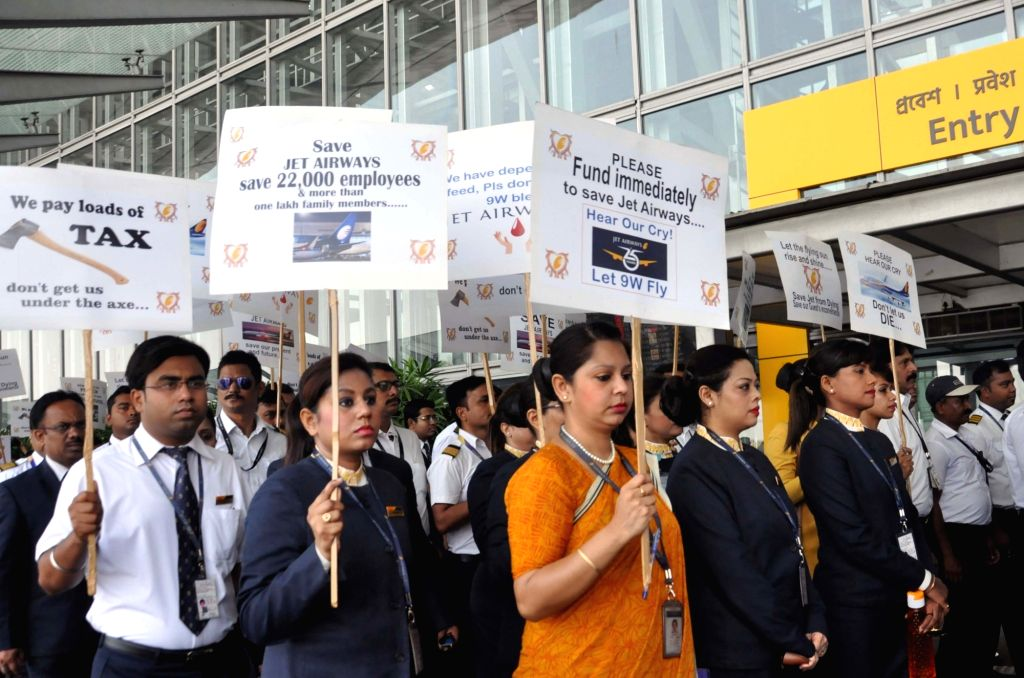 Employees of the debt-ridden Jet Airways stage a demonstration appealing the Central Government to save the airline, at Netaji Subhash Chandra Bose International Airport in Kolkata, on April ...