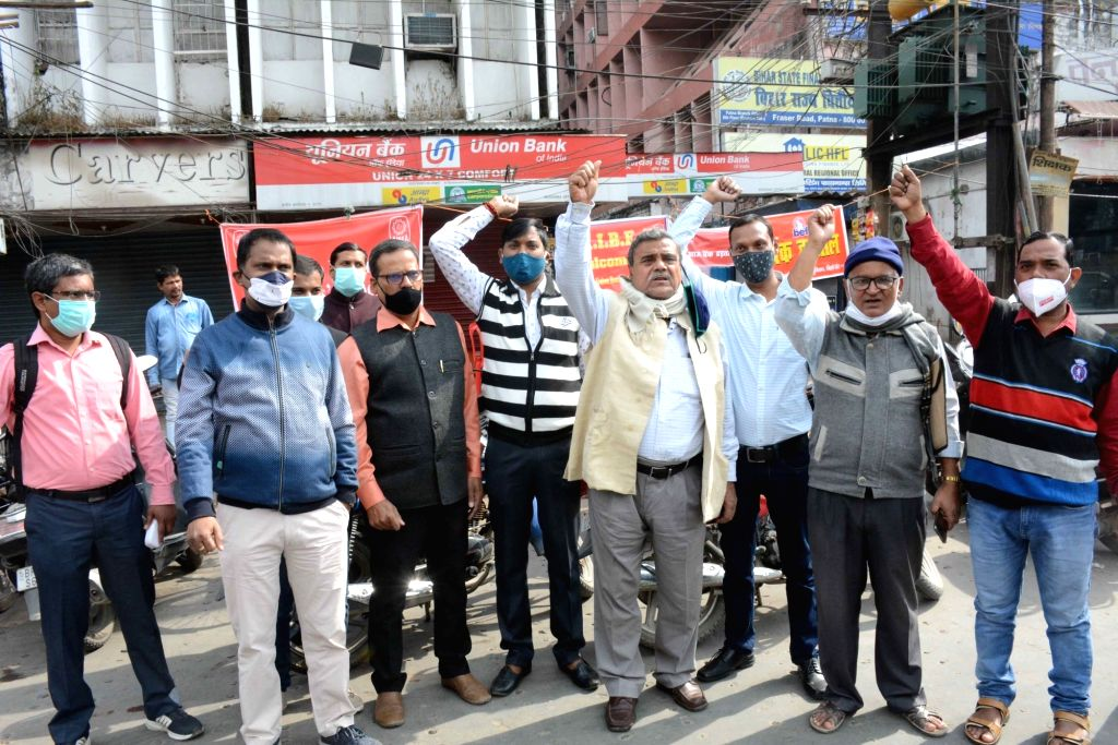 Employees of Union Bank protest during the 24-hour nationwide trade union strike called by the central trade unions against the central government's new farm and labour laws, in Patna on Nov ...