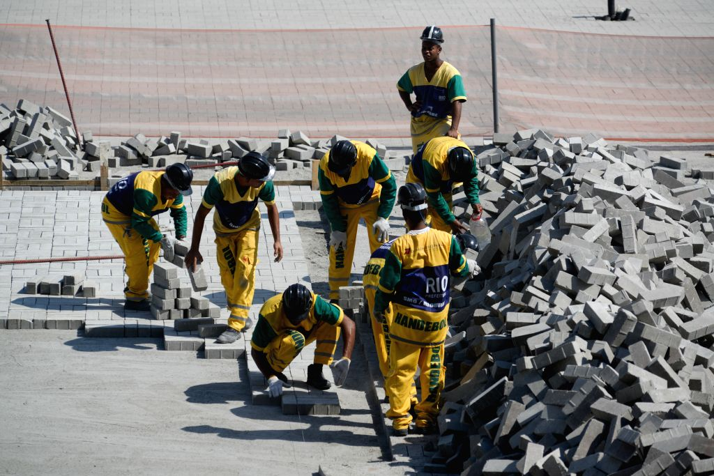 Employees work on the construction of the Olympic Park in Barra Tijuca, in Rio de Janeiro, Brazil, on Aug. 5, 2015. According to local press, Carlos Arthur ...
