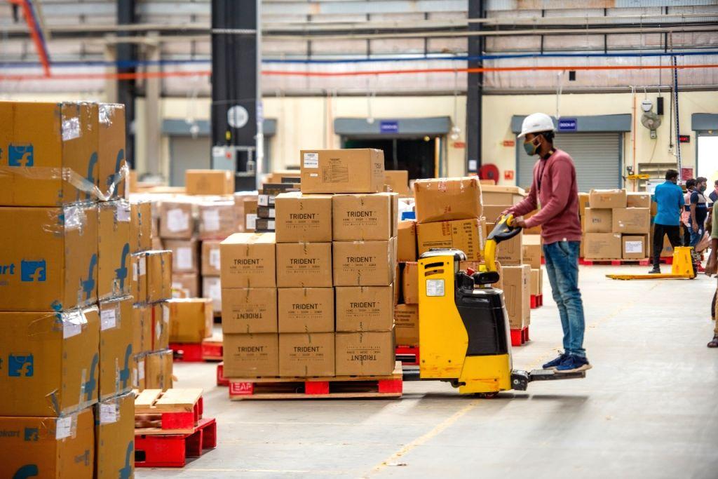 Employees working at Flipkart warehouse.