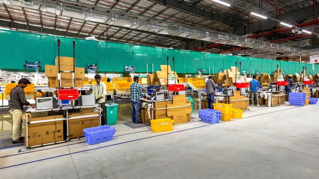 Employes at the Amazon's newly launched fulfillment Centre in Karnataka, near Attibele outskirt of Bengaluru on Sept 18, 2018.