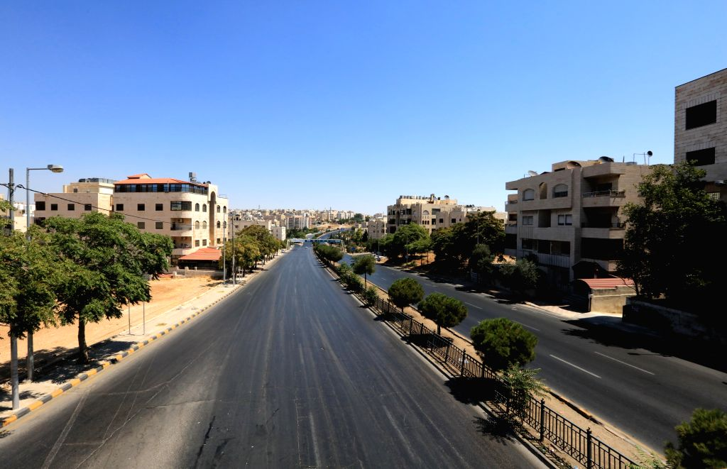 Empty streets are pictured during a curfew in Amman, Jordan, Aug. 28, 2020. Jordan imposed a full curfew on Friday in Amman and Zarqa after a hike in the number of ...