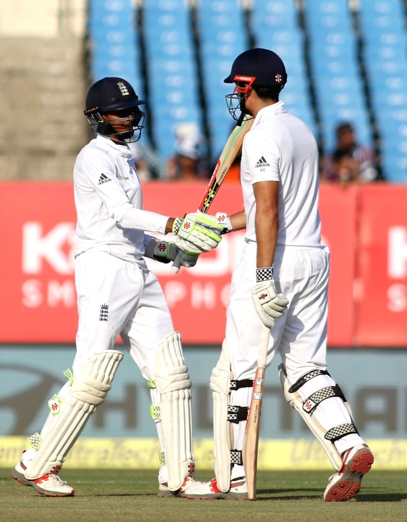 England batsman Haseeb Hameed celebrates Half century  on the fourth day of the first cricket test match between India and England in Rajkot  on Nov. 12, 2016. - Haseeb Hameed