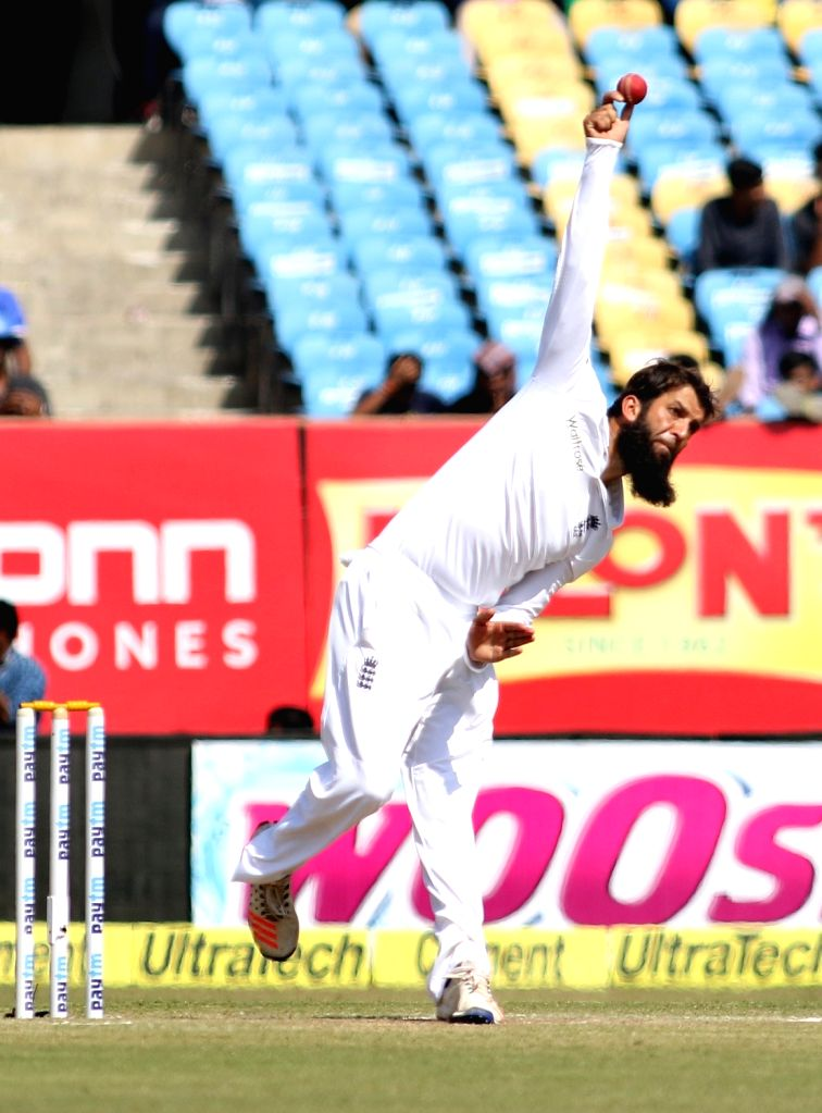 England bowler Moeen Ali bowls on the fourth day of the first cricket test match between India and England in Rajkot on Nov. 12, 2016. - Moeen Ali