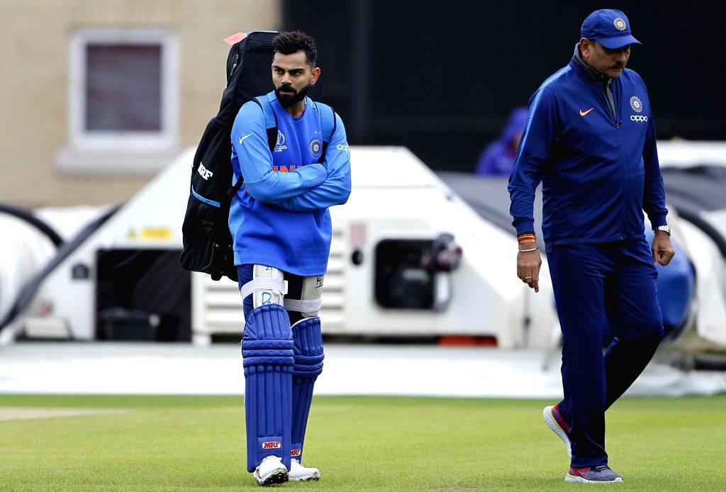 England: Indian coach Ravi Shastri and captain Virat Kohli during a practice session ahead of the 2019 World Cup match against New Zealand, at Trent Bridge Cricket Ground in Nottinghamshire, England on June 12, 2019. (Photo: Surjeet Yadav/IANS) - Virat Kohli and Surjeet Yadav