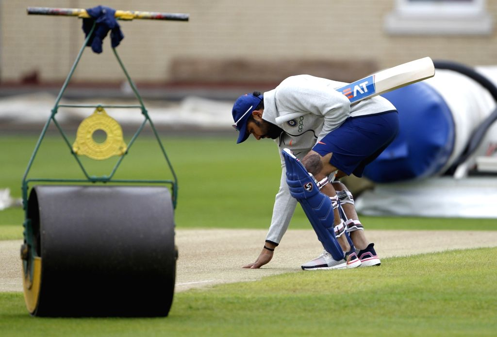 England: Indian cricketer Rohit Sharma inspecting the pitch during a practice session ahead of the 2019 World Cup match against New Zealand, at Trent Bridge Cricket Ground in Nottinghamshire, England on June 12, 2019. (Photo: Surjeet Yadav/IANS) - Rohit Sharma and Surjeet Yadav