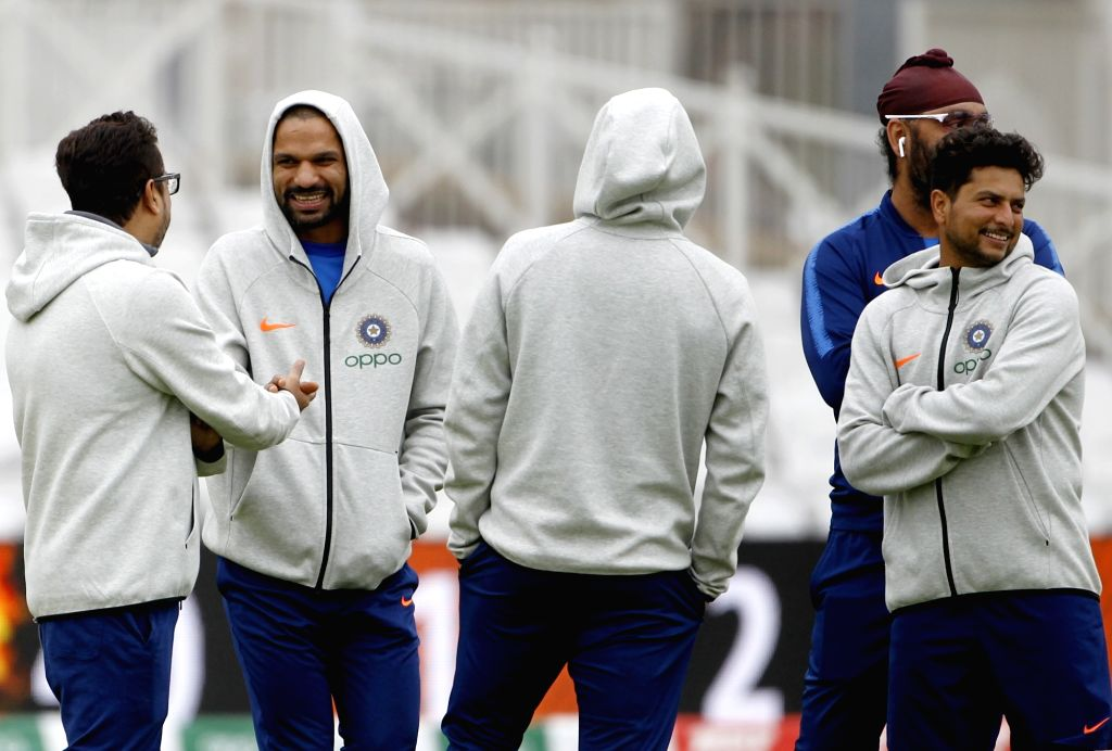 England: National selector Sarandeep Singh with Indian cricketers Shikhar Dhawan and Kuldeep Yadav during a practice session ahead of the 2019 World Cup match against New Zealand, at Trent Bridge Cricket Ground in Nottinghamshire, England on June 12, - Shikhar Dhawan, Sarandeep Singh, Kuldeep Yadav and Surjeet Yadav