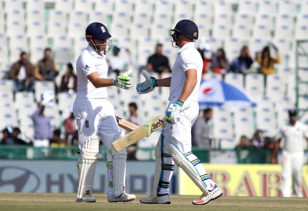 England player Jonathan Bairstow celebrates half century during the first day of their third cricket test match against India in Mohali on Nov. 26,  2016.