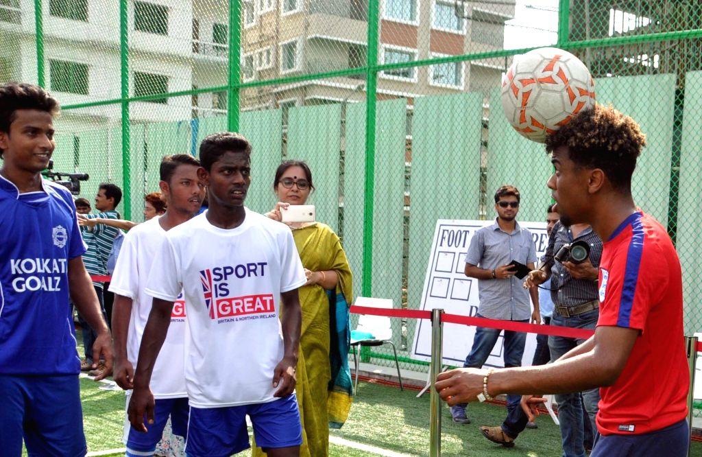 England U-17 football players Jadon Sancho, Angel Gomes, Joel Latibeaudiere interact with school students at New Town in Kolkata on Oct 12, 2017.