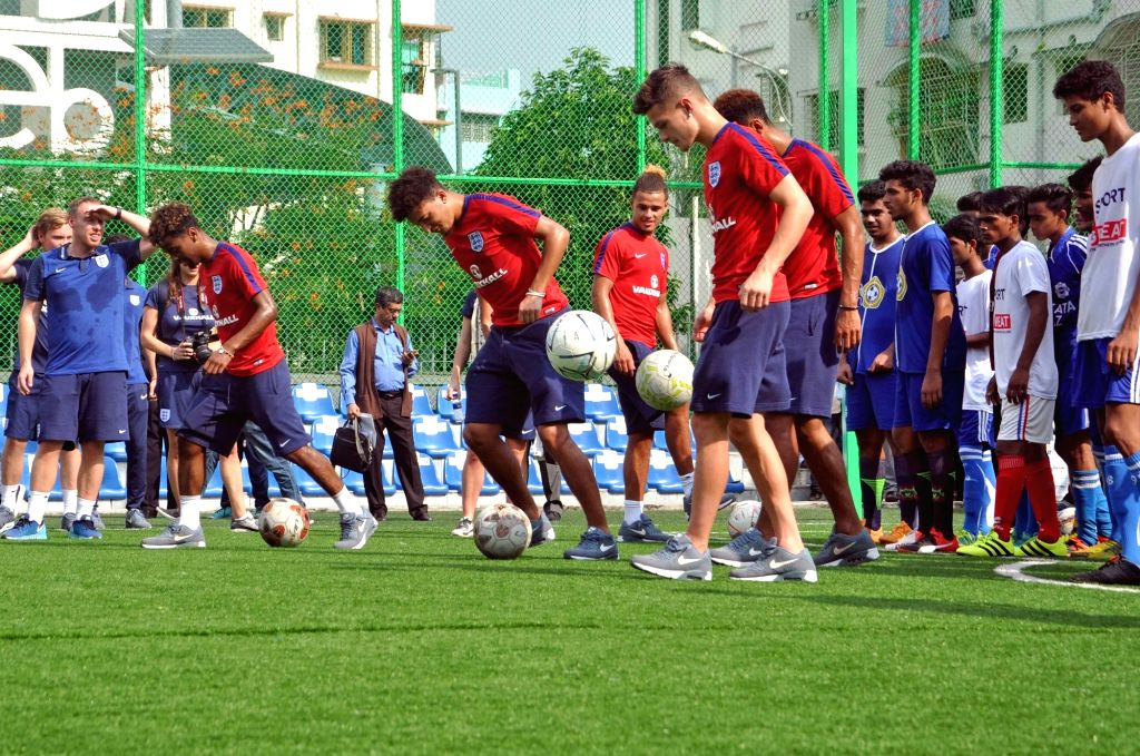 English FIFA U-17 player Angel Gomes interacts with school students at New Town in Kolkata on Oct 12, 2017.