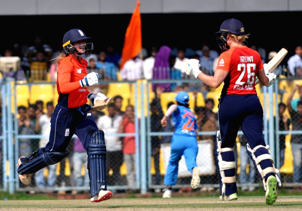 English players celebrate after winning the second T20I match against India in Guwahati on March 7, 2019.