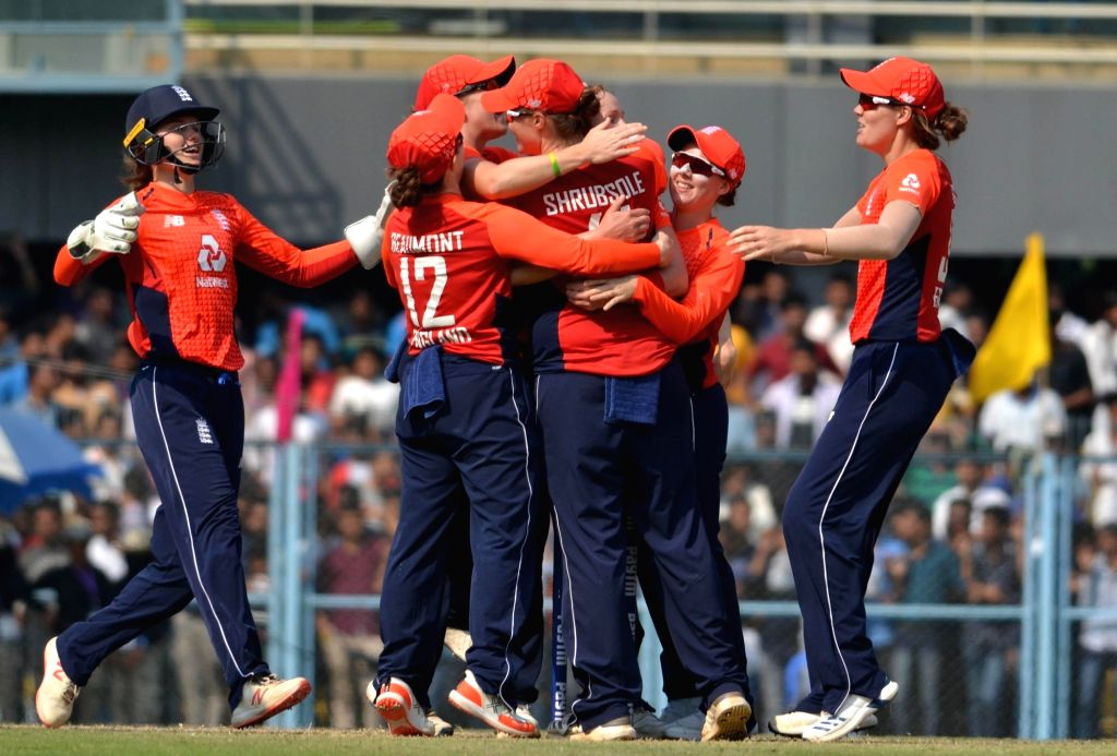 English players celebrate after winning the third Women's T20I match against India at Barsapara Cricket Stadium in  Guwahati on March 9, 2019.