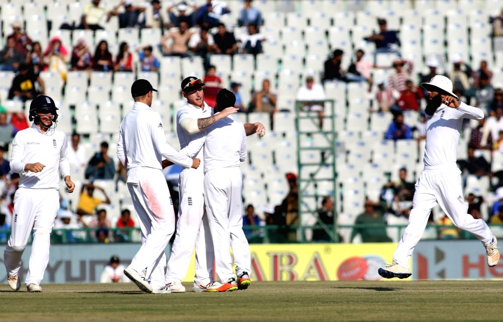 English players celebrate fall of Ajinkya Rahane's wicket on Day 2 of the third test match between India and England at Punjab Cricket Association IS Bindra Stadium, Mohali on Nov 27, 2016.