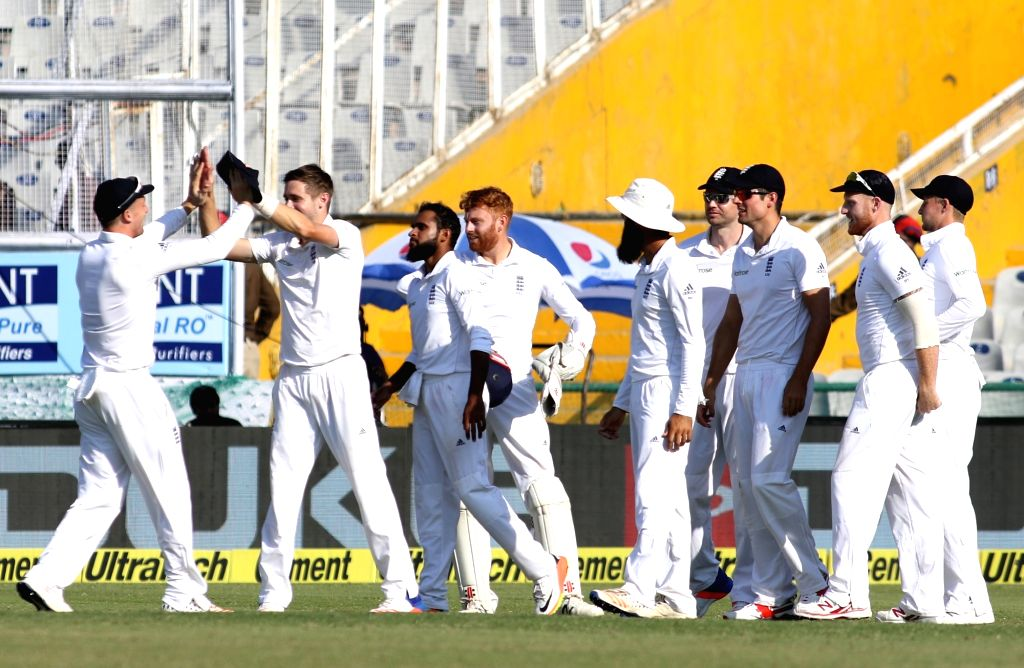 English players celebrate fall of Cheteshwar Pujara's wicket on Day 2 of the third test match between India and England at Punjab Cricket Association IS Bindra Stadium, Mohali on Nov 27, 2016.